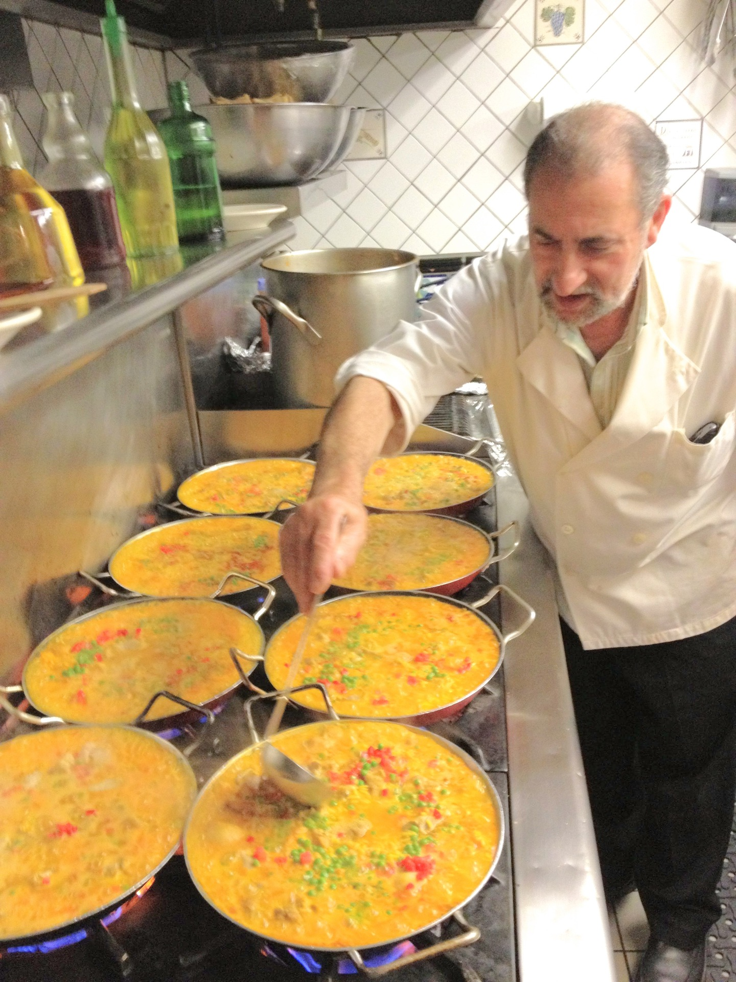 Chef Carlos preparing paellas